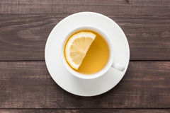 Ginger tea with lemon on the wooden background Stock Photos