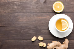 Ginger tea with lemon on the wooden background Stock Images