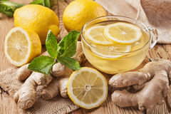 Ginger tea. With lemon on a wooden table stock images