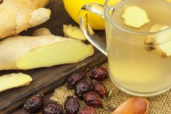 Ginger tea. Natural treatment for colds and flu. Ginger, lemon, honey and rosehip tea against influenza. Stock Photography
