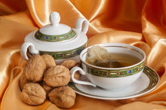 Ginger tea and orange with nuts Stock Images