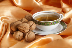Ginger tea and orange with nuts Stock Photos