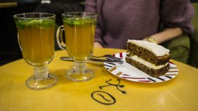 Ginger tea and a slice of carrot cake. Applied blur ambient background stock photo
