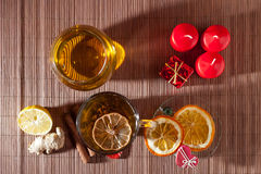 Ginger tea with spices, honey, cinnamon, lemon and dried fruit Stock Image