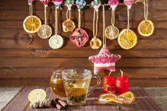 Ginger tea with spices, honey, cinnamon, lemon and dried fruit Stock Photography