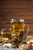 Ginger tea with spices, honey, cinnamon, lemon on a linen background Stock Photo
