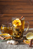 Ginger tea with spices, honey, cinnamon, lemon on a linen background Royalty Free Stock Photos