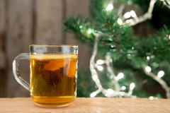 Ginger tea in a cup on wooden background royalty free stock image