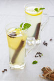 Ginger tea. Ginger warms medical tea with lemon vertical photo Stock Image
