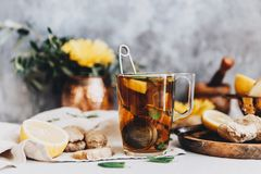 Ginger tea in white cup with fresh ginger. And lemon Royalty Free Stock Images