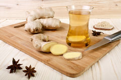 Ginger tea on a wooden background Stock Images