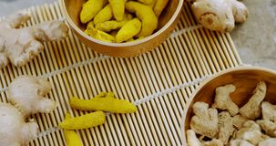 Ginger and turmeric stick on bamboo placemat 4k