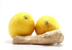 Ginger with two lemons. Isolated on white background royalty free stock photos
