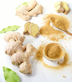Ginger on white wooden board Royalty Free Stock Photo