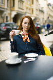 Ginger woman with coffee cup. Royalty Free Stock Photos