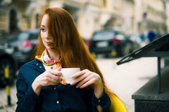 Ginger woman with coffee cup. Stock Image