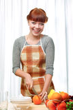 Ginger woman at kitchen Stock Images