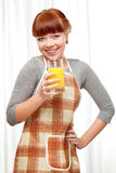 Ginger woman at kitchen Stock Image