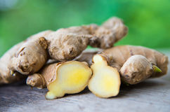 Ginger on wood texture. Stock Photography