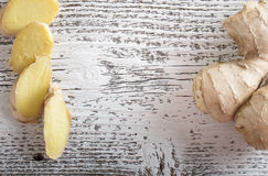Ginger on wooden background Royalty Free Stock Photography