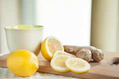 Ginger and yellow lemon with cup and copy space Stock Photo