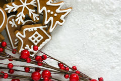 Gingerbread. Homemade christmas cookies - gingerbread on snow background Royalty Free Stock Photo