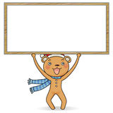 Gingerbread bear holding a notice board. Cartoon action icon of gingerbread bear holding a white notice board Royalty Free Stock Photo