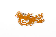 Gingerbread bird's - dove's figure,  snow. Christmas tree, New Year, winter decors. Sugar frosted cookies. Christmas decorations.  on white Stock Images
