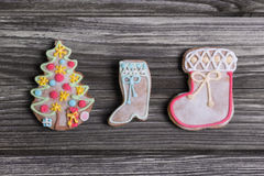 Gingerbread or biscuits for christmas on wooden background. Royalty Free Stock Images