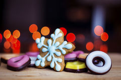 Gingerbread blue star with colored candy in different shapes Royalty Free Stock Photography