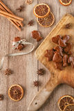 Gingerbread on board with baking ingredients like cinnamon, orange slices and star anise, christmas background Stock Images
