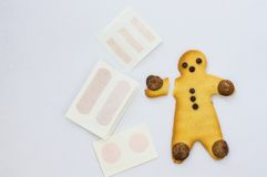 Gingerbread Boy with a broken arm Royalty Free Stock Photography