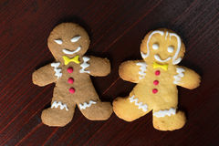 Gingerbread boy and   girl on a wooden table Royalty Free Stock Photography