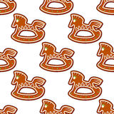 Gingerbread brown horses seamless. Pattern background for christmas design Royalty Free Stock Photo