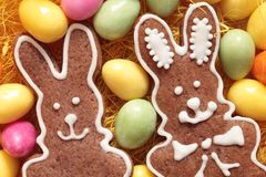 Gingerbread bunny. Close-up of Easter gingerbread cookies and candy eggs royalty free stock photography