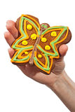 Gingerbread butterfly in hand Royalty Free Stock Image
