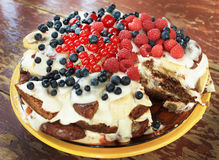 Gingerbread cake with fresh berries. The cake is made of carrots, bananas and sour cream Royalty Free Stock Photography