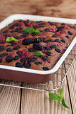 Gingerbread cake with mulberries and red currants Royalty Free Stock Images