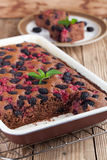 Gingerbread cake with mulberries and red currants. Shallow dof Stock Image