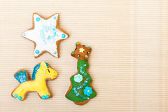 Gingerbread cake pony christmas tree star with icing decoration on brown. Homemade gingerbread cake pony christmas tree and star with icing and colorful royalty free stock photos