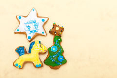 Gingerbread cake pony christmas tree star with icing decoration on brown Royalty Free Stock Photos