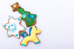 Gingerbread cake pony christmas tree star with icing decoration on white. Homemade gingerbread cake pony christmas tree and star with icing and colorful royalty free stock photo