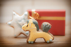 Gingerbread cake pony star icing decoration red gi Stock Photo