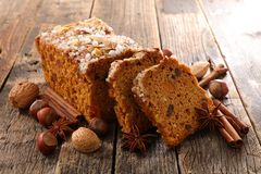 Gingerbread cake and spice. On wood stock photography