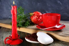 Gingerbread, candle and Christmas ball. Stock Photography