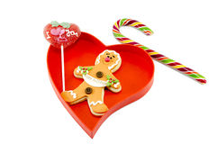 Gingerbread a candy cane and a lollipop in box Royalty Free Stock Image