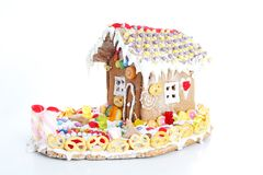 Gingerbread candy sugar house. Fairy tail candyhouse covered with snow and colorful candies Homemade gingerbread house. With colorful candy decoration royalty free stock images