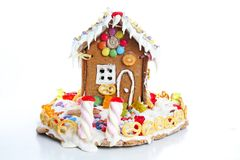 Gingerbread candy sugar house. Fairy tail candyhouse covered with snow and colorful candies Homemade gingerbread house. With colorful candy decoration stock photography