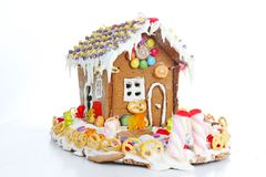 Gingerbread candy sugar house. Fairy tail candyhouse covered with snow and colorful candies Homemade gingerbread house. With colorful candy decoration royalty free stock photos