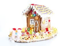 Gingerbread candy sugar house. Fairy tail candyhouse covered with snow and colorful candies Homemade gingerbread house. With colorful candy decoration stock photo